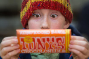 Boy looking with amazement at huge chocolate bar