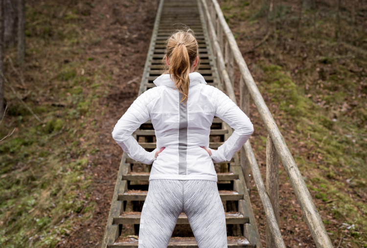 Determined female athlete in front of stairs