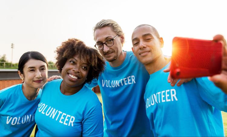 Diverse group of volunteers taking a selfie