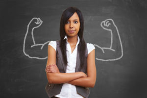 Fearless young woman standing in front of muscle drawing