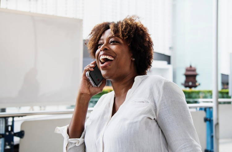 Happy woman speaking on a cell phone