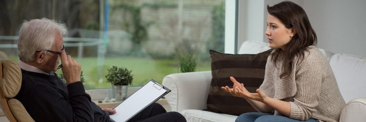 Female patient speaking with a therapist