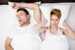 Woman being kept awake by snoring partner