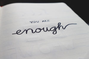 """You are enough"" written on page"